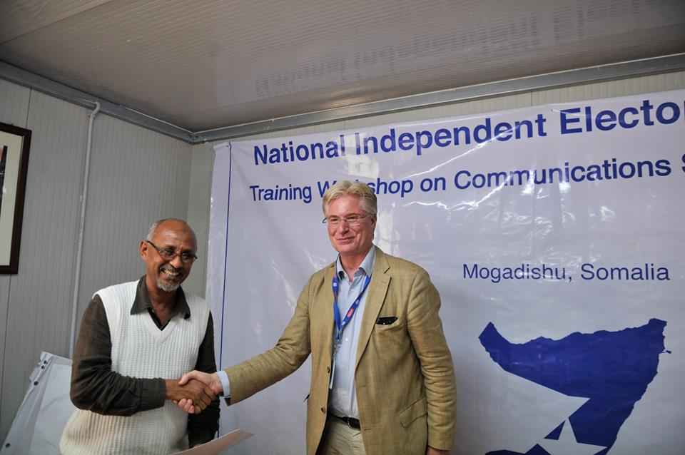Gerald Mitchell UNSOMs Chief Electoral Advisor hands over a certificate October 08 2015 1 Homepage - Magazine