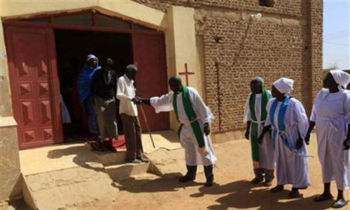 pastors help south sudanese worshippers after attending sunday prayers in baraka parish church at hajj yusuf on the outskirts of khartoum february 10 2013. reuters mohamed nureldin abdallah d9326 Homepage - Loop