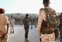 Lt. Col. Iman Elman, who is in charge of planning for the Somali National Army, overseeing troops before their deployment in anti-Shabab operations.Credit...Luca Bucken